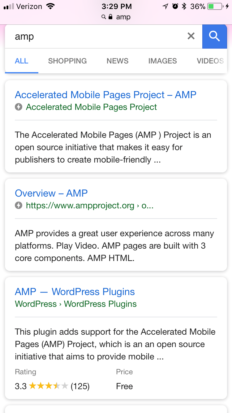 AMP symbol next to search listing.