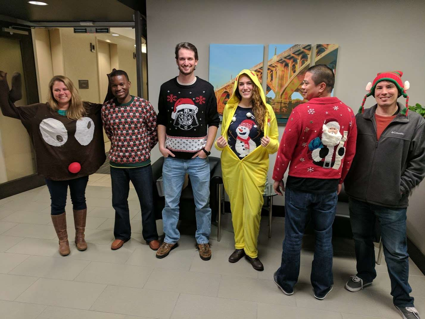 A variety of ugly Christmas sweaters.